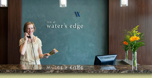 College of Dupage Waters Edge Logo Applied to a Wall Behind the Reception Desk